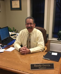Picture of President Randy Garcia sitting at his desk.